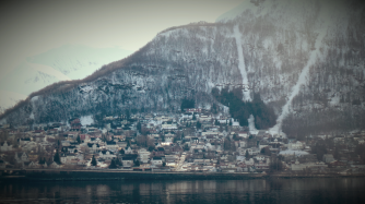 Landscape scene in Norway - mountain with houses on it
